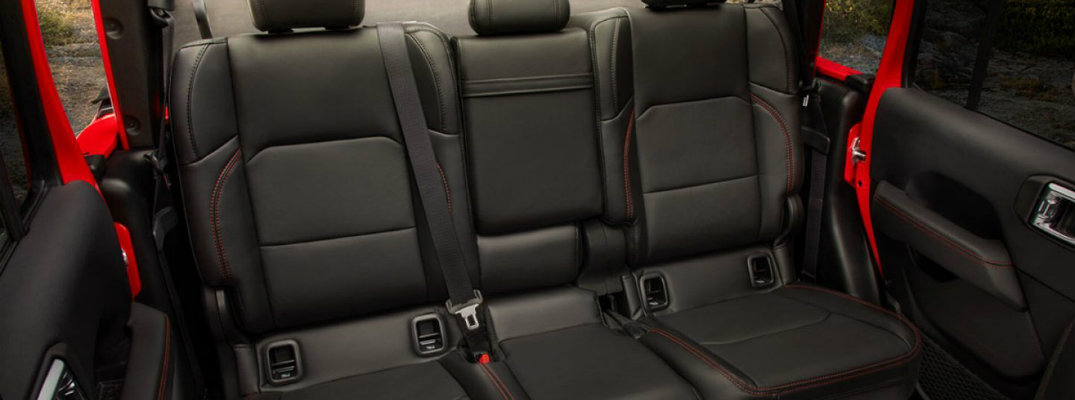2020 Jeep Gladiator pickup truck interior shot of back row black cloth upholstery