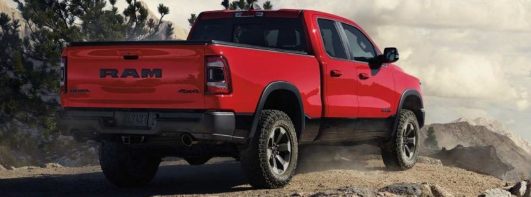 Rear shot of red 2019 RAM 1500 Rebel parked on rocky ridge