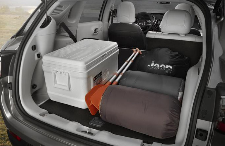 luggage in the cargo area of 2018 Jeep Compass