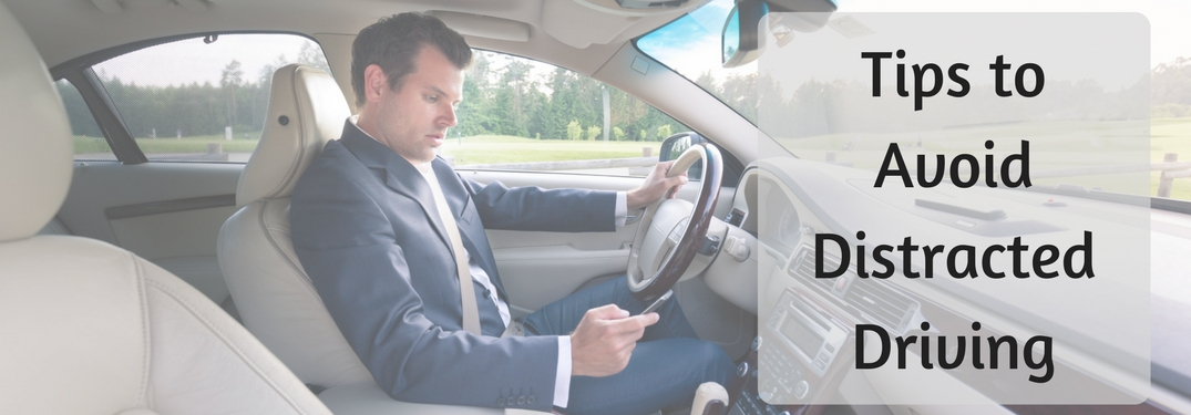 man on cell phone in car, tips to avoid distracted driving