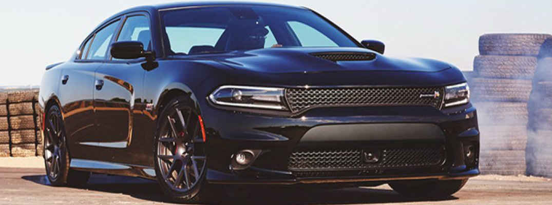 Black 2019 Dodge Charger burning out in front of tires