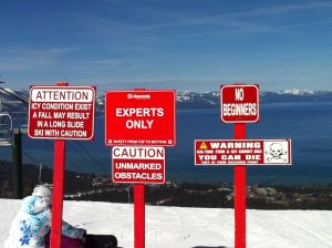 Experts Only signs and Lake Tahoe in background.