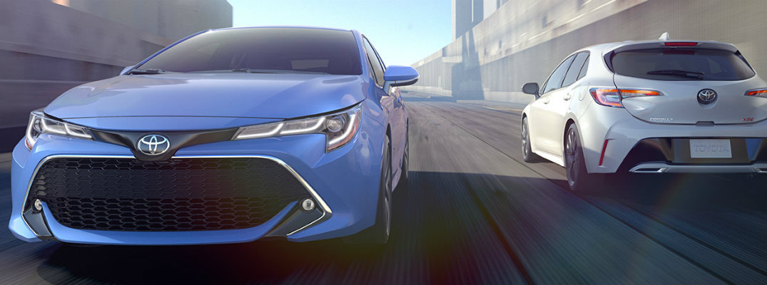 Two 2019 Toyota Corolla Hatchback models driving on city road