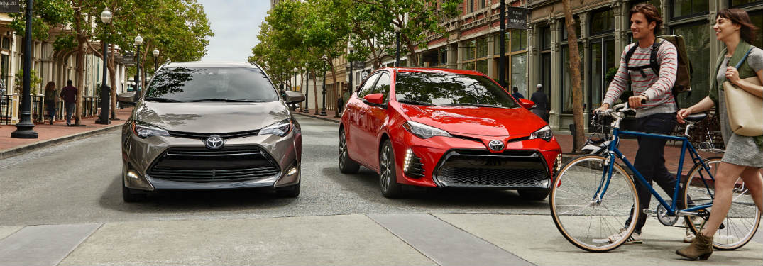 Two 2018 Toyota Corollas stopping for a biker