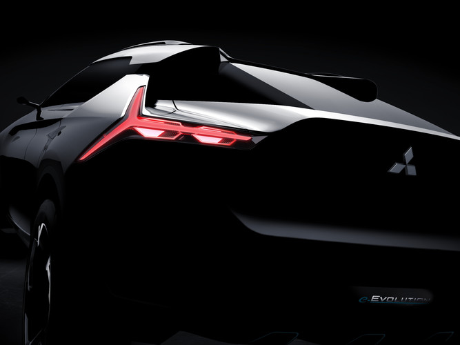 darkened image of the styling lines and unque y-shaped taillight of the mitsubishi e-evolution concept