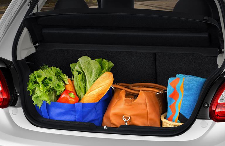 hatch of the 2018 Mitsubishi Mirage with its cargo area filled with groceries