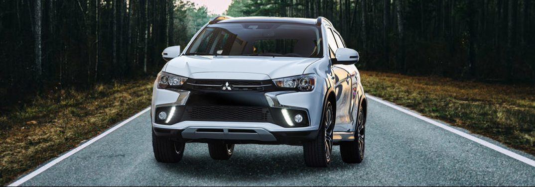 2018 Mitsubishi Outlander Sport parked in the middle of the road in the forest