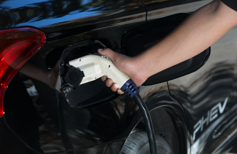 Driver charging the 2018 Mitsubishi Outlander PHEV