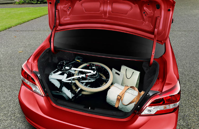 View of a red 2018 Mitsubishi Mirage G4 with the trunk popped open showing the amount of cargo it can hold