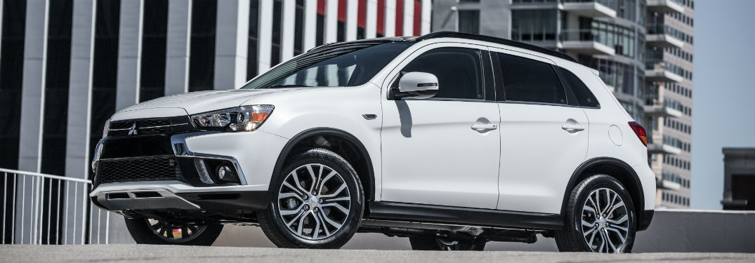 side view of a white 2018 Mitsubishi Outlander Sport