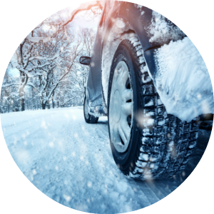 circular image of car driving through snow