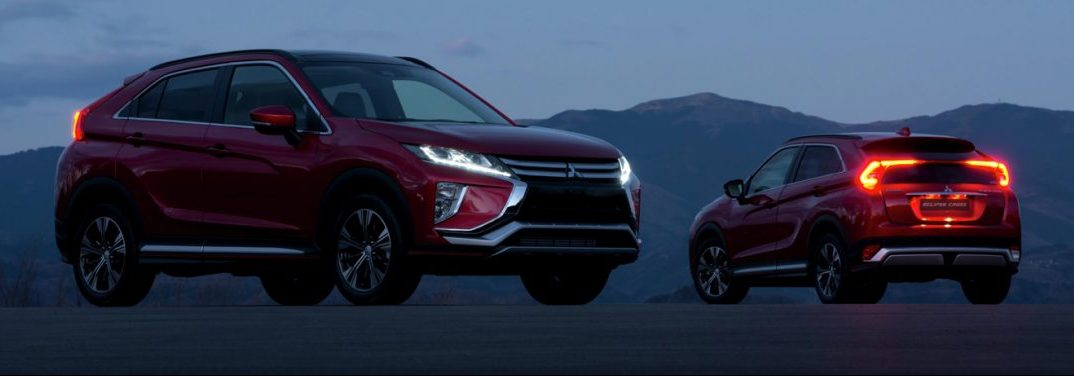 2019 Mitsubishi Eclipse Cross models parked on mountain at dusk