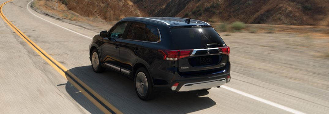 exterior rear of the 2019 Mitsubishi Outlander driving in a desert