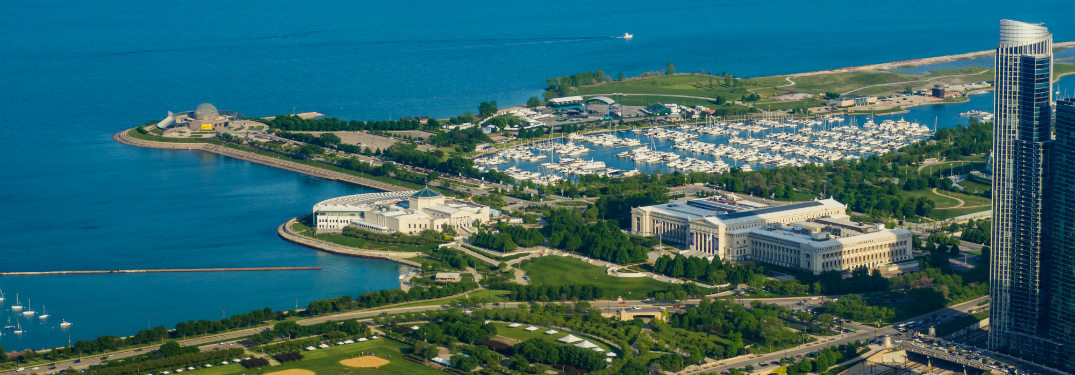 Aerial view of area of Chicago bordering Lake Michigan, with several museums in view.
