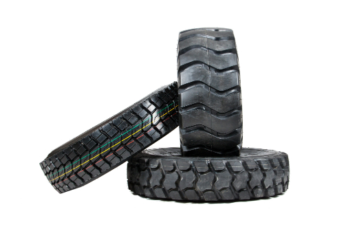 Three different kinds of tires lean on one another against a white background.