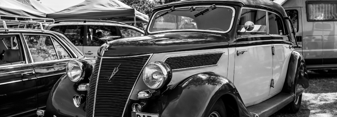 A black and white photo of a Ford Model V8