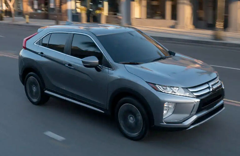 Grey 2020 Mitsubishi Eclipse Cross driving up a city street