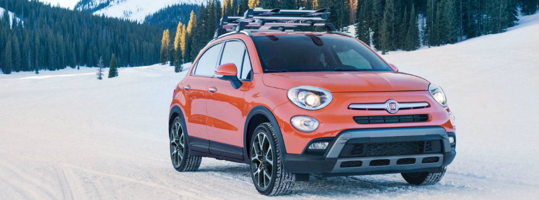 Exterior shot of 2017 Fiat 500x driving on snowy terrain