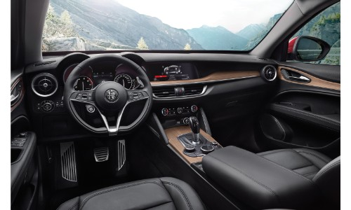 2019 Alfa Romeo Stelvio Ti Sport interior shot of front seating, steering wheel, transmission, and dashboard style