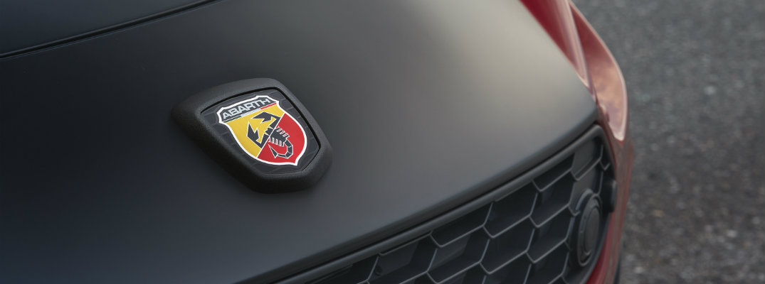 2019 Fiat 124 Spider Abarth exterior close up shot of fascia and grille with Abarth badge embedded on the hood