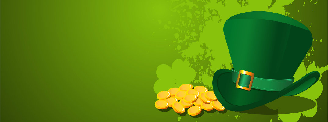 a St. Patrick's Day leprechaun hat with a pile of gold and splashes of green paint shaped like shamrocks behind it