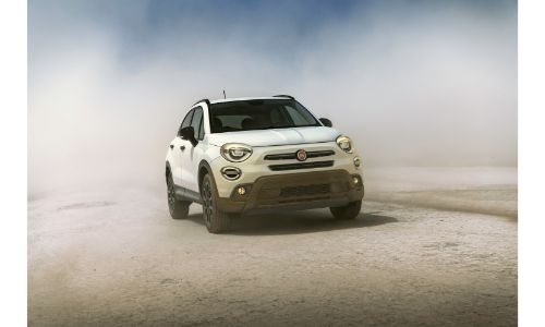 2019 Fiat 500X Urbana Edition exterior front shot with white clear coat paint color parked within a dust cloud
