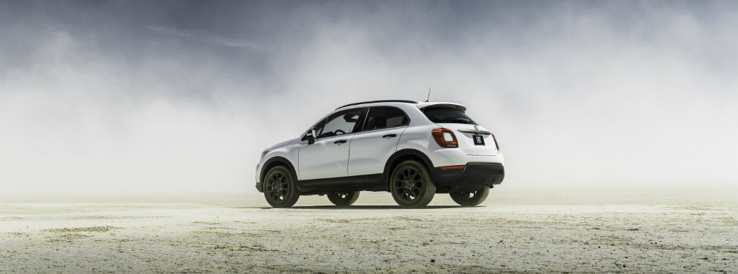 2019 Fiat 500X Urbana Edition exterior side shot with bianco gelato white clear coat paint color parked on sand within a dust cloud
