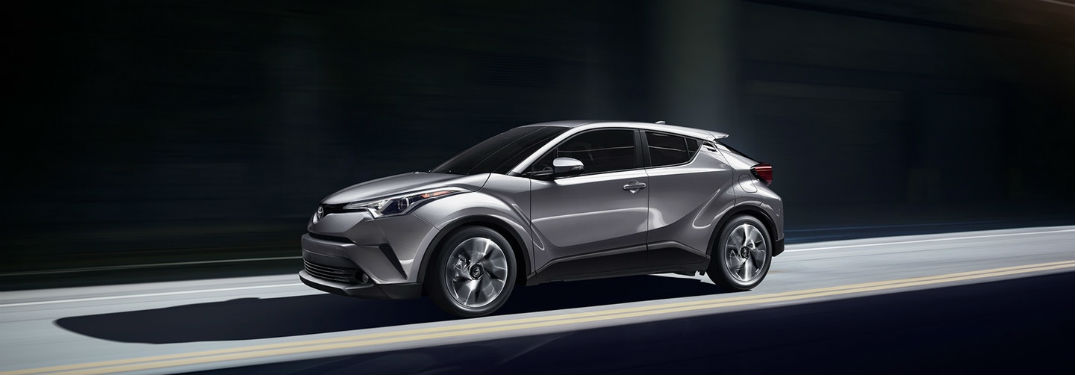 Driver's side exterior view of a grey 2018 Toyota C-HR