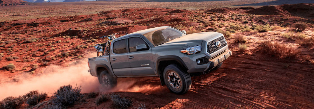 Passenger side exterior view of a gray 2018 Toyota Tacoma