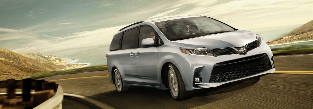 2018 Toyota Sienna exterior front fascia and passenger side going fast on blurred oceanside road
