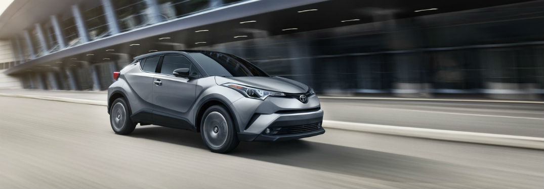 2019 Toyota C-HR exterior front fascia and passenger side going fast on blurred road