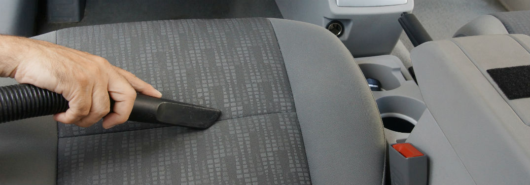 vacuuming seat of car