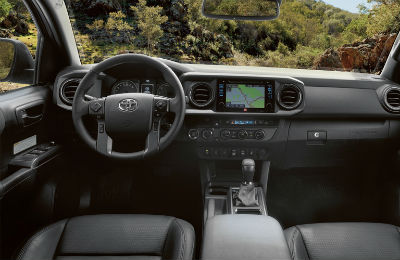2019 Toyota Tacoma interior front cabin steering wheel and dashboard