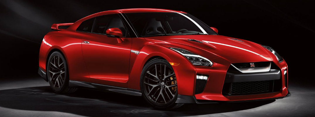 2018 Nissan GT-R luxury sports car red paint color exterior shot in black showcase room