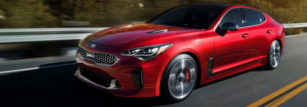 red 2018 Kia Stinger driving down a road