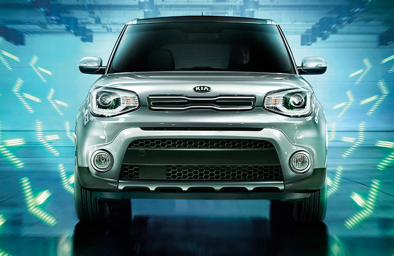 front grille of silver 2019 Kia Soul with teal background