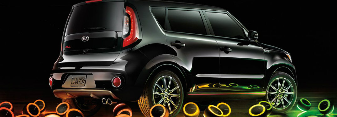 black-2019-Kia-Soul-parked-in-dark-room-with-different-colored-speakers-surrounding