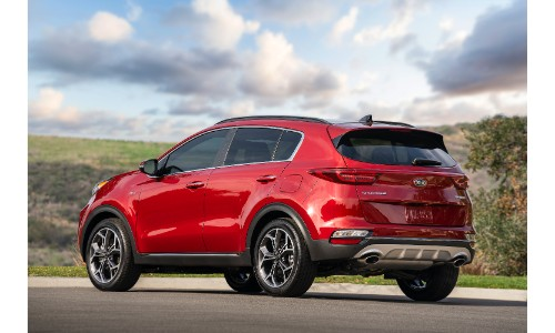 2020 Kia Sportage SUV redesign exterior rear shot showing back bumper and taillight design while parked under a cloudy blue sky