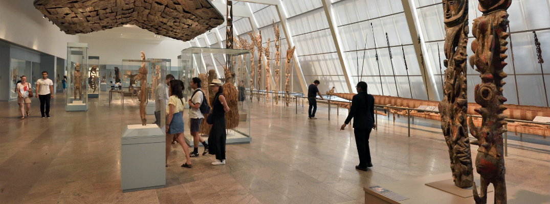 New York City Metropolitan Museum of Art interior exhibit as people walk through and admire the pieces