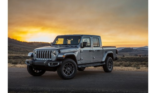 2019 Jeep Gladiator pickup truck exterior shot with billet silver metallic paint color parked in the wilderness at sunset