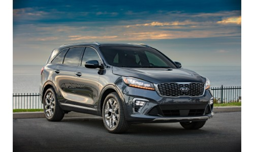 2019 Kia Sorento exterior shot with gray metallic paint color parked near a fence on a hill near the sea
