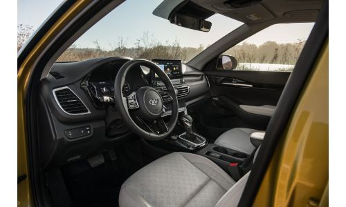 2021 Kia Seltos interior shot of driver's seat, steering wheel, and dashboard design and layout