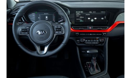 2020 Kia Niro Touring interior shot of driver's view of steering wheel, dashboard,  and driver's display