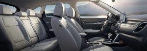 2021 kia seltos interior side shot of seating row in white