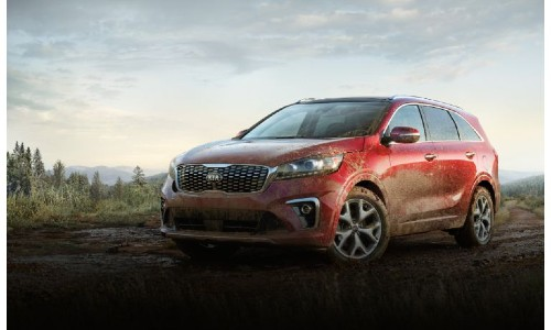 2020 Kia Sorento exterior shot with red paint color splattered and caked with mud