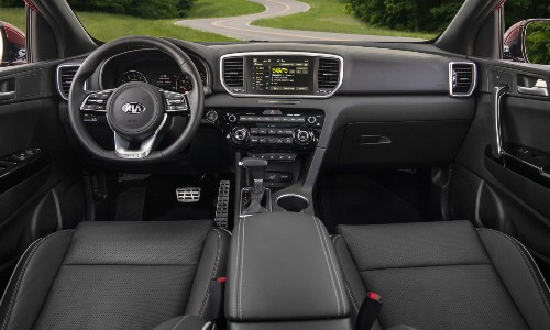 2021 Kia Sportage interior shot of front seating, steering wheel, and dashboard