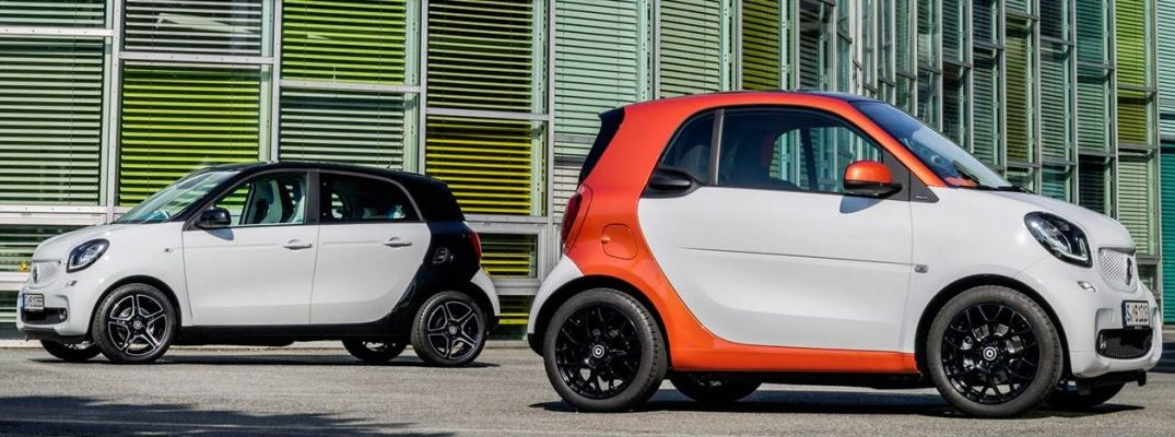 2016 smart fortwo orange and black models parked near each other