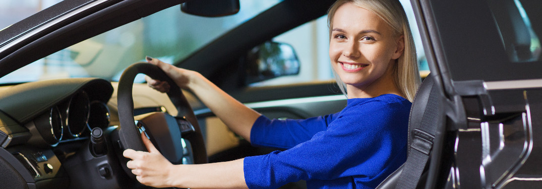 blonde woman in car smiling