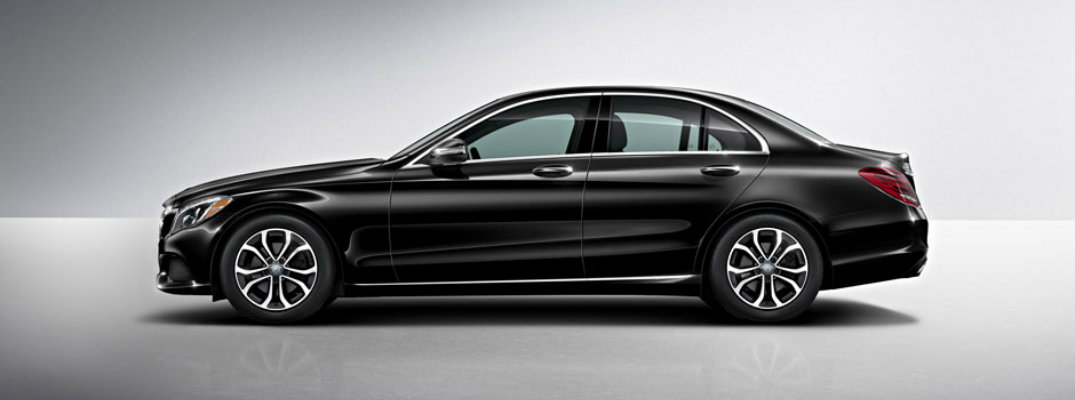 Profile shot of black 2018 Mercedes-Benz C 350e plug-in hybrid on gray background