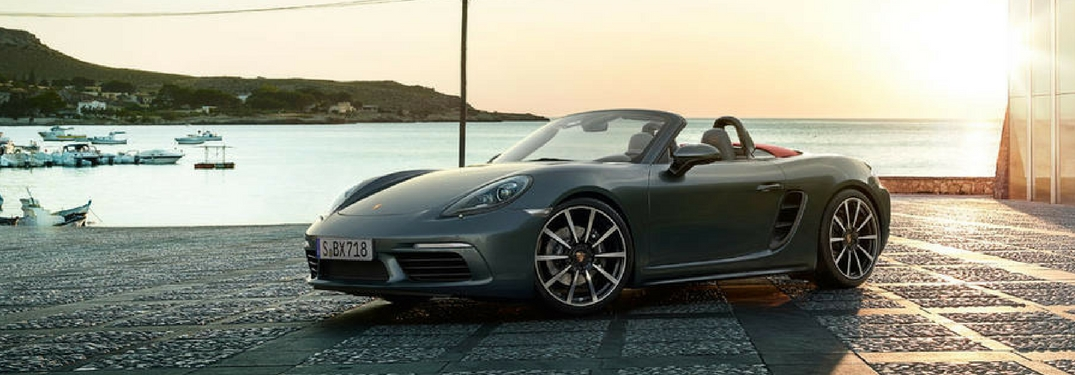 2018 porsche 718 boxster parked by a pier at sunset